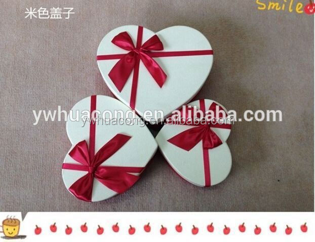 white heart shape paper box with ribbon