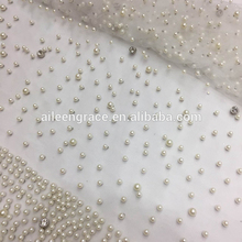 Wholesale white beaded lace tulle fabric with shiny diamonds for making garment