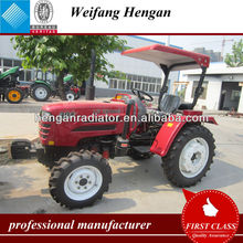 Small farm tractor with tractor canopy