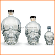 Eco-friendly clear glass skull bottle for liquor