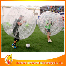 Large inflatable soap football playing at grass