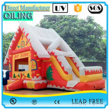 Cheap inflatable bouncy castle jumping house with slide ,customized christmas bouncer combo