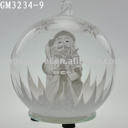 hanging glass LED snow globes with a santa claus inside