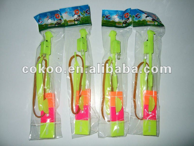 top sell and high quality LED Light Flash Flying Elastic Powered Arrow Sling Shoot Up Helicopter