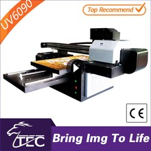 Go ahead you can rely on TEC uv flatbed plastic button printing machine