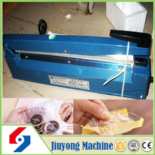 2015home use small newest designtray sealing machine