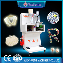 Trustworthy china supplier snap button fixing machine,pearl and four-claw nail riveting machine