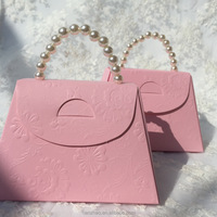 Cute Handbag Design Paper Folding Sweet Boxes with Pearl Handle for Wedding Christmas Door Gift