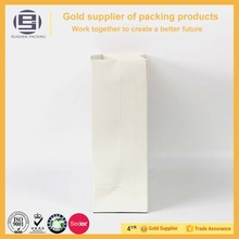 Customized long and thin white shopping bags filled with relatively long articles