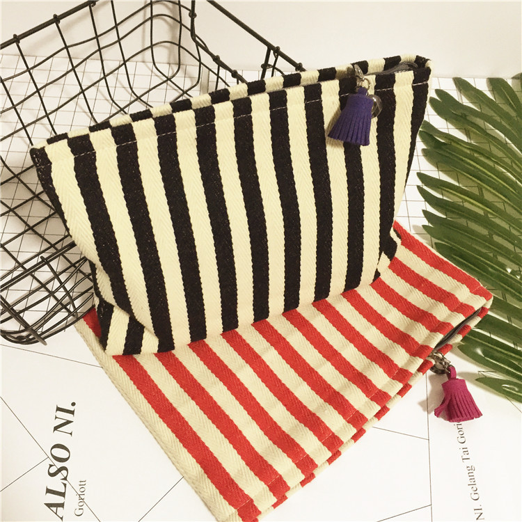 Striped Canvas female cosmetic bag thickened tassel pendant new fashion trends of Japanese makeup handbag