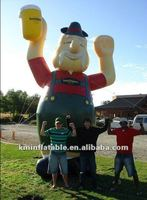 inflatable old man with with a beer glass in hand