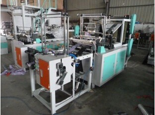 Plastic double layer feeding rolled rubbish bag making machine