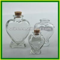 With corks heart shaped clear glass bottle 100ml
