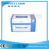 Small simple operation mini paper laser cutting machine price 6040