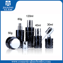 luxury glass cosmetic bottle jar packaging on stock with pump and printing