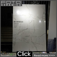 Polished carrara and calacatta ceramic tile for the wall and floor