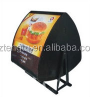 Rotatable double sided curve menu light box
