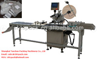 automatic labels applicator for plastic bags