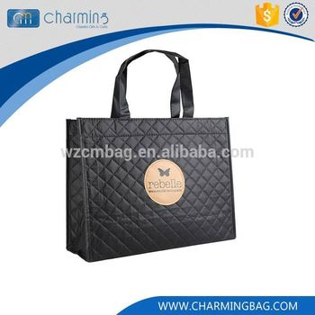 Top fashion attractive style cloth Top fashion simple design handles black embossing non woven bag