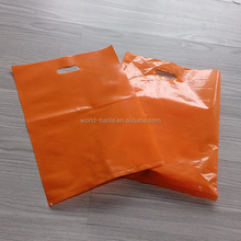 100% Recyclable 1.25 mil Thick Orange Plastic Die Cut Shopping Bags