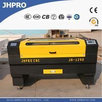 Discounted!!!plastic paper glass mdf wood acrylic leather fabric CO2 laser cutting machine Price