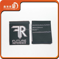 Folded fabric clothing labels and tags