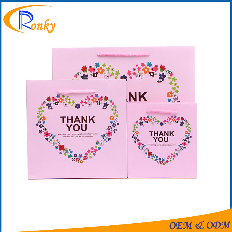 Pink thank you paper gift bag for bridal party to place gifts inside