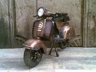 miniature metal Vespa motorcycle