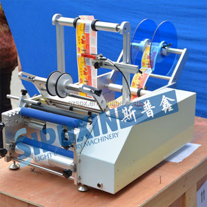 Semi-automatic bottle labeling machine