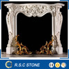 Carved by hands white marble fireplace