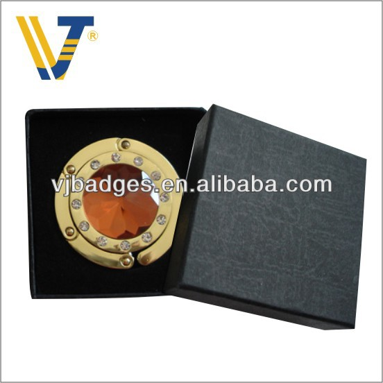 Round gold plated bag hanger with gift box