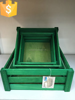 retangular green wood crates