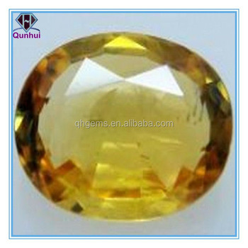 golden yellow oval shaped cubic zirconia gemstone