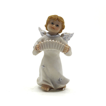 Resin male angel playing violin statues