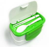 Plastic food container with spoon and chopsticks