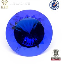 Round brilliant cut pointed back blue glass stone
