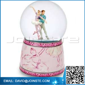 Dancing couples snow globe