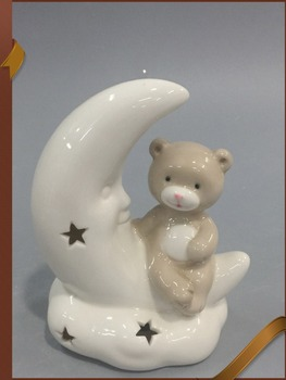 Collectible porcelain angel figurines with sitting bear