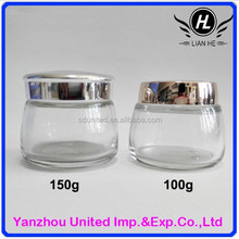 Wholesale 100g/150g clear glass facial mask jar with silver lid