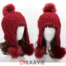 red faux fox fur pom pom knitted beanie hat with earflaps