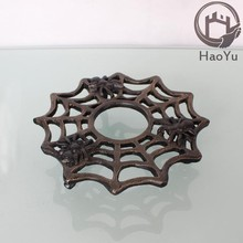 spider style metal cast iron trivet for home decoration