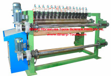 Jumbo roll slitter rewinder machine for abrasive cloth