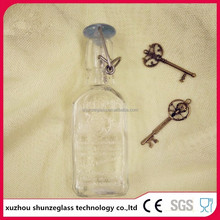 2016 wholesale China factory customized glass juice bottle with swing top