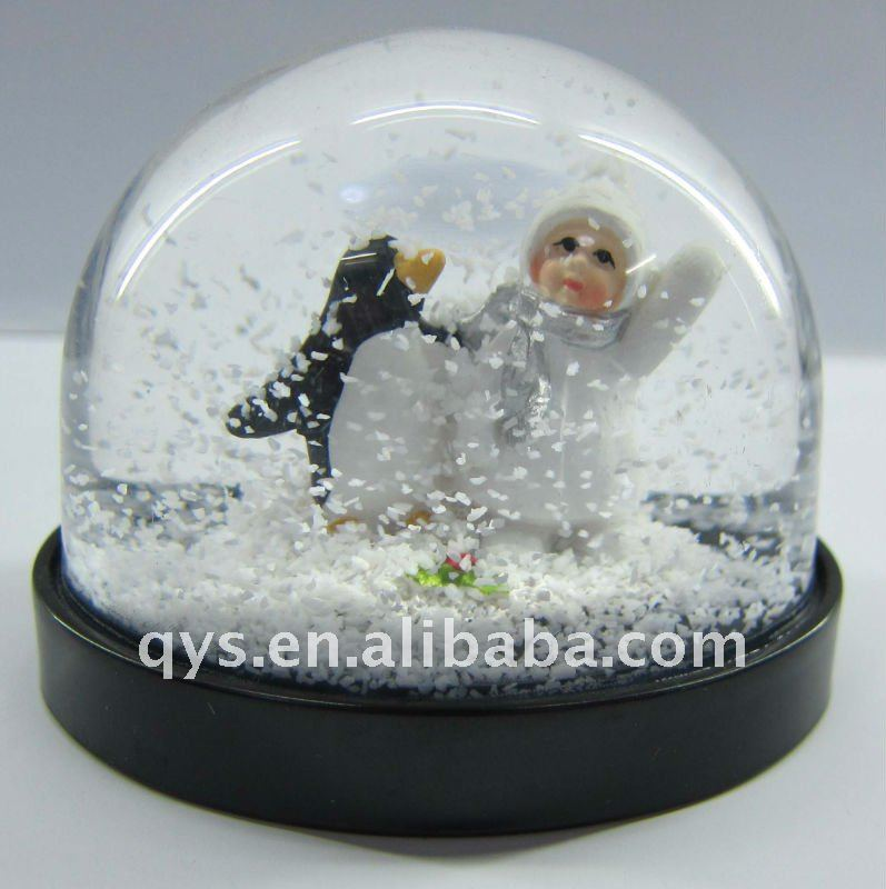 kid and penguin water globe