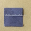 Small navy blue velvet pouch embossed logo