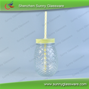 glass mason jar with cover and straw