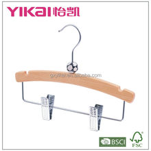 Wooden baby clothes hanger with ball and clips