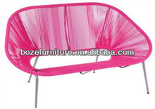 Patio pink curved acapulco loveseat wicker bench