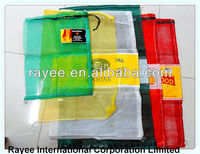 Red and green raschel mesh bag for packing vegetable