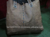 Brown handmade buffalo leather shopping bag with black details
